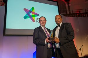The Rt Hon. James Duddridge, Minister for Africa, presenting The Business of the Year award to the Abdirashid Duale, CEO of Dahabshiil Bank.