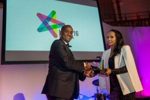 Senior Aljazeera Correspondent Mohammed ado, presenting the Most Effective Initiative of the Year Award to Adeso Africa.