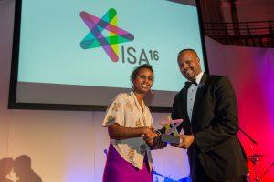 Nadifa Mohamed, Somali novelist, presenting the Highest Educational Achiever to Hawa Jama Abdi but Abdihafid Jama, Somali TV presenter received on behalf of her.